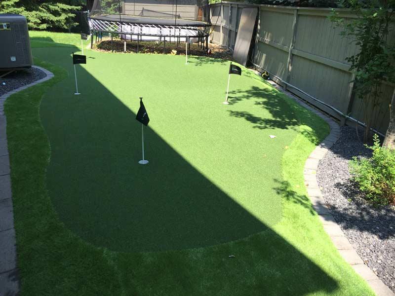 Backyard putting green artificial turf installation